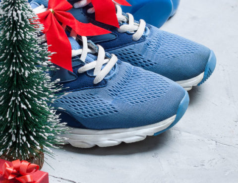 68781509 - christmas sport composition with blue sport shoes, blue dumbbells, red gift box, christmas tree and bottle of water on gray concrete background. concept ?hristmas special for healthy lifestyle and sport.