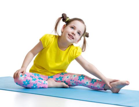 39299153 - kid girl doing fitness exercises on mat